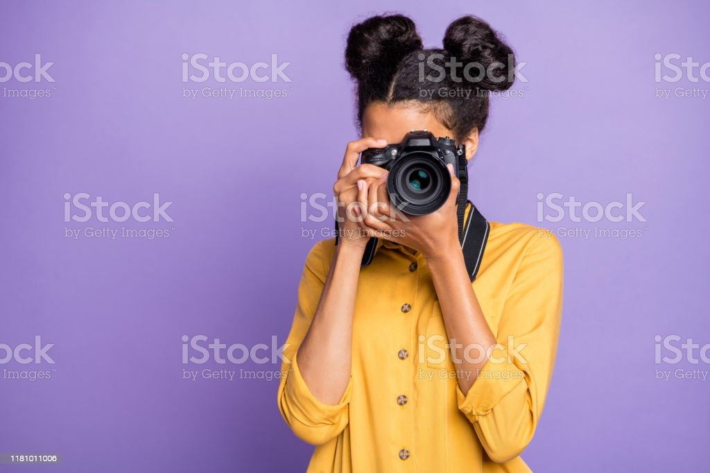 Photo of amazing dark skin lady holding photo digicam in hands photographing foreign sightseeing abroad wear yellow shirt trousers isolated purple color background Photo of amazing dark skin lady holding photo digicam in hands photographing, foreign sightseeing abroad wear yellow shirt trousers isolated purple color background Adult Stock Photo
