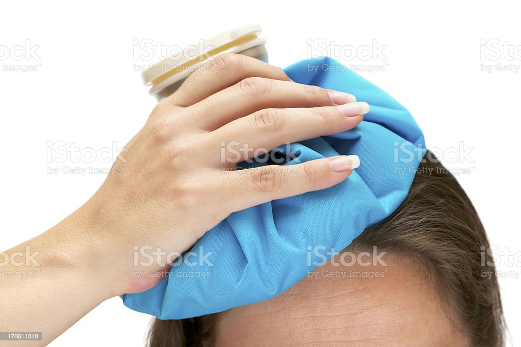 Photo of an aching head with ice bag royalty-free stock photo