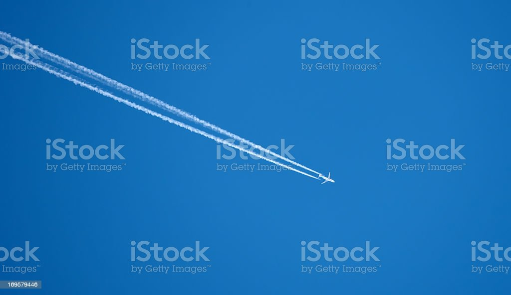A  photo of an airplane high in the sky royalty-free stock photo