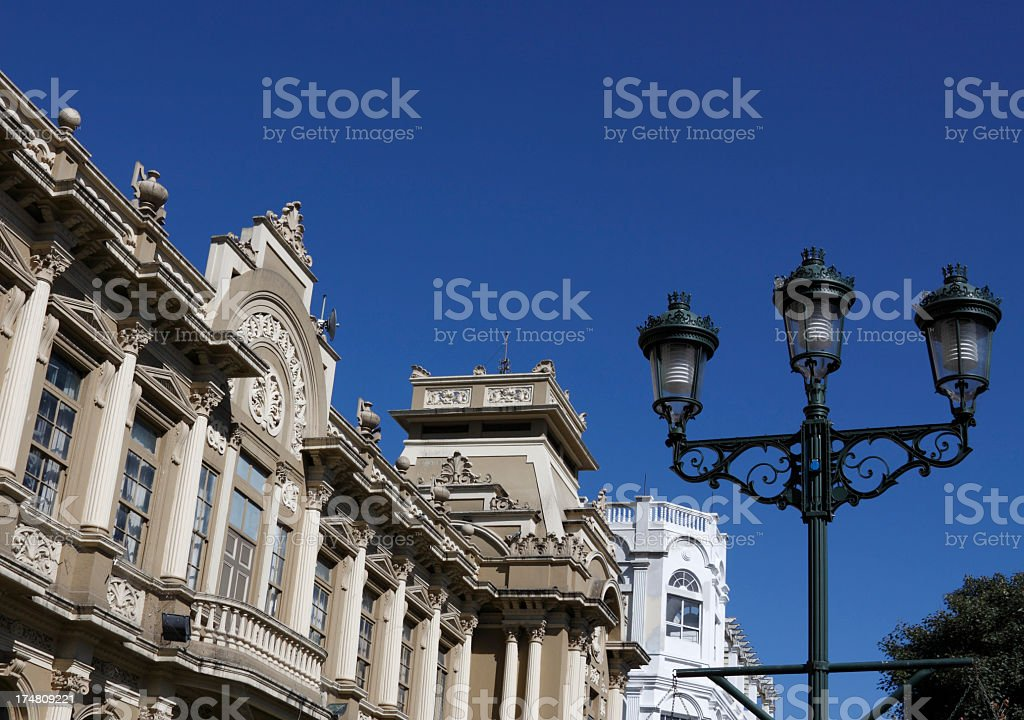 Photo of an old post office building under a clear sky Old Post Office building in downtown of San Jose, Costa Rica. Architectural Column Stock Photo
