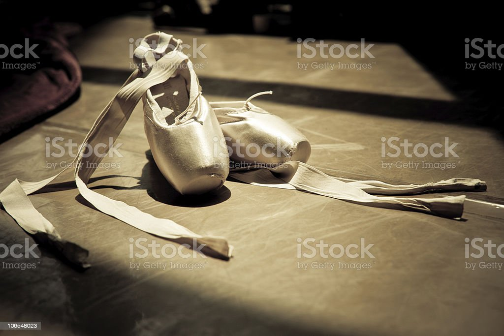 Photo of ballet slippers on the studio floor stock photo