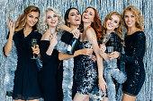istock Photo of beautiful girls celebrating new year 615919752