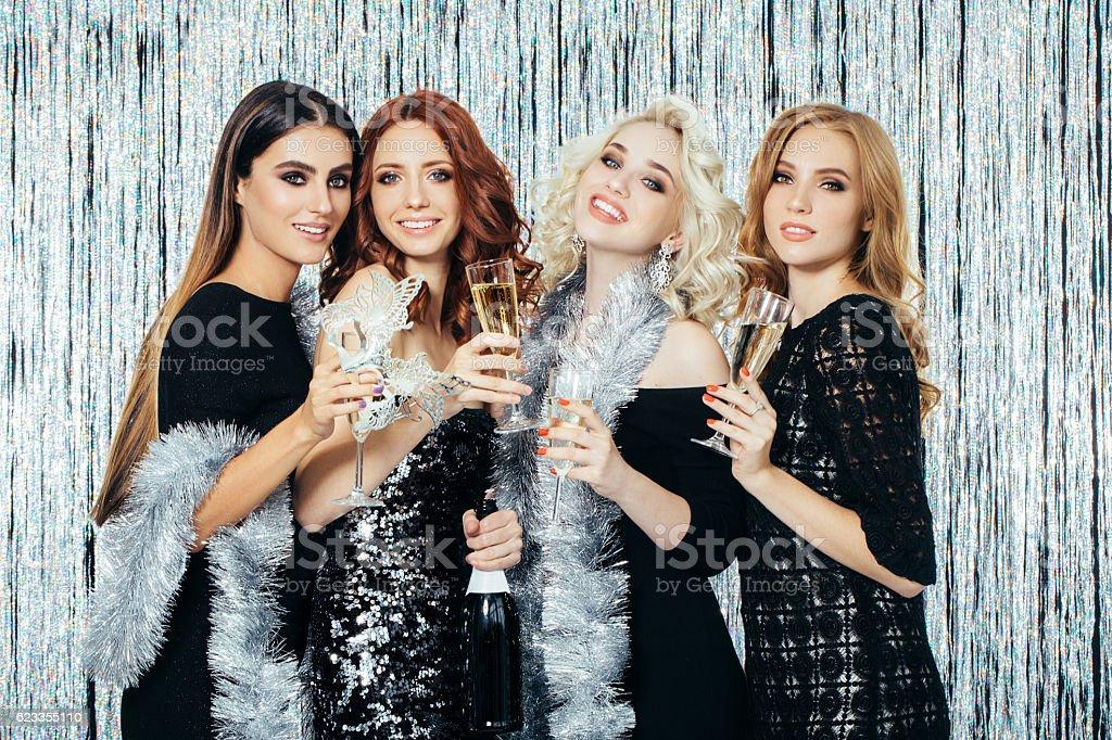 Photo of beautiful girls celebrating new year stock photo