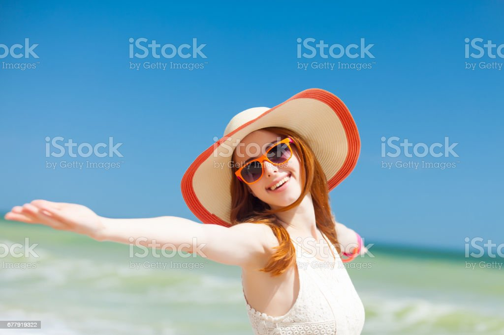 photo of beautiful young woman standing on the wonderful sea background royalty-free stock photo