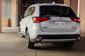 istock Photo of black Mitsubishi Outlander in covered parking. 1192697649