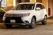 istock Photo of black Mitsubishi Outlander in covered parking. 1192697673