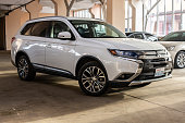 istock Photo of black Mitsubishi Outlander in covered parking. 1192697683