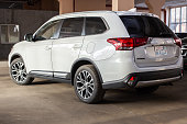 istock Photo of black Mitsubishi Outlander in covered parking. 1192697693