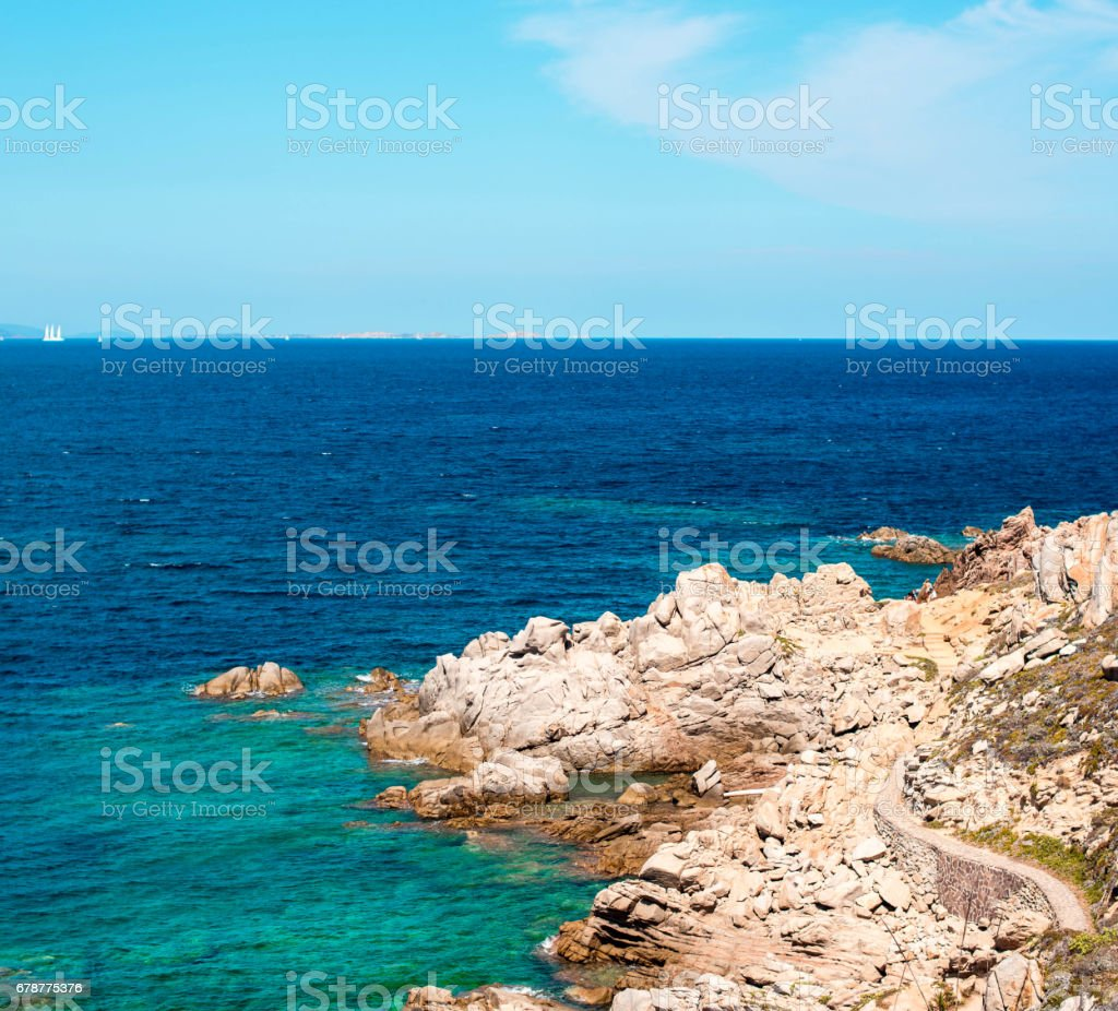 Photo of blue sea on the island with stones royalty-free stock photo