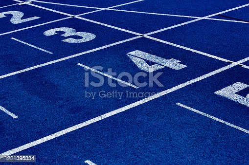 istock Photo of blue stadium tracks 1221395334