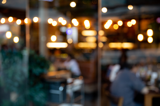 Photo of blurred restaurant or cafe. Abstract bokeh light. Background concept.