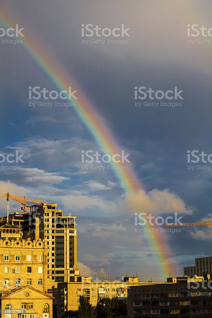 Photo of bright colorful rainbow over city royalty-free stock photo
