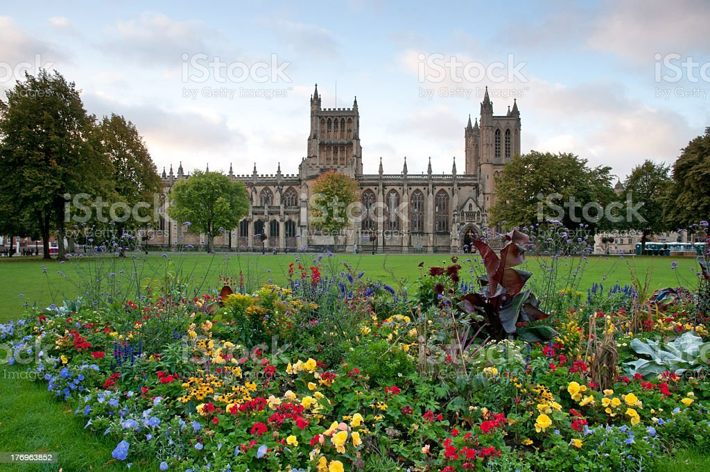 Photo of Bristol Cathedral behind colorful flowers stock photo