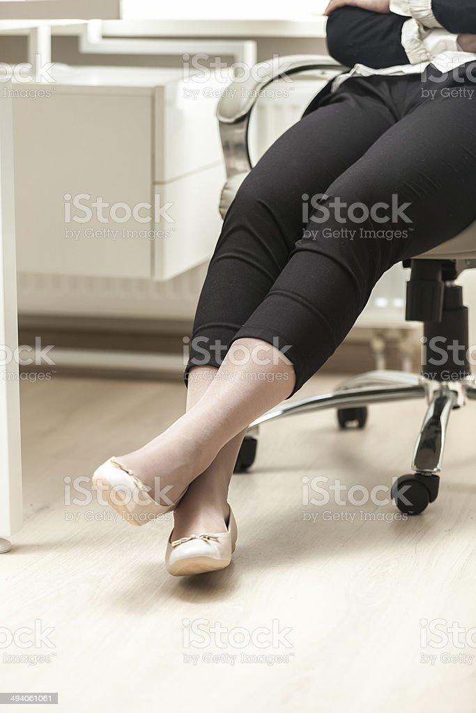 photo of businesswoman wearing comfortable ballet flats stock photo