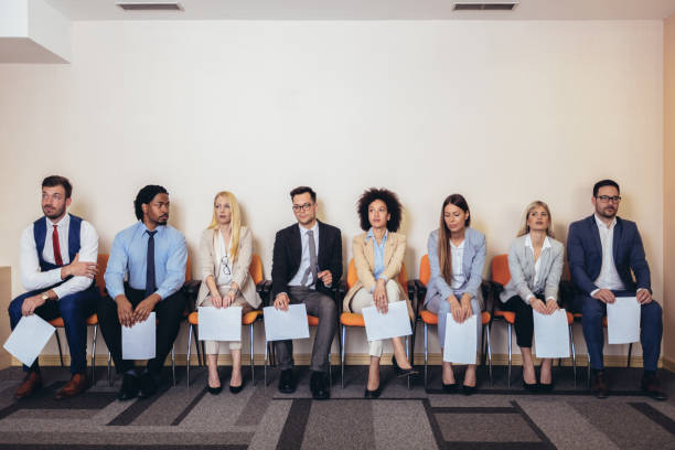 Photo of candidates waiting for a job interview. Photo of candidates waiting for a job interview. Selective focus applicant stock pictures, royalty-free photos & images