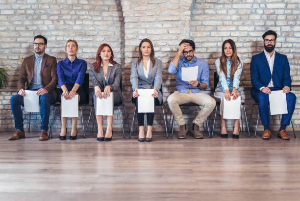 photo of candidates waiting for a job interview - job search stock photos and pictures