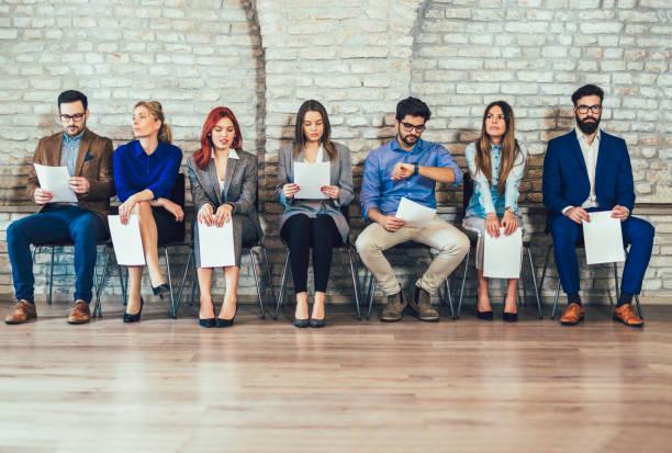photo of candidates waiting for a job interview - fare la fila foto e immagini stock