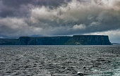 photo of cape north take from a merchant ship in summer time