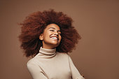 istock Photo of cheerful curly girl with positive emotions 1182617637