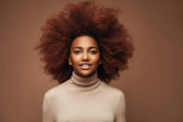Photo of cheerful curly girl with positive emotions stock photo