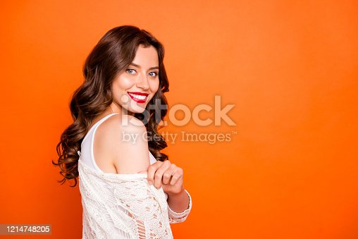 Photo of cheerful positive cute nice toothy sweet pretty girlfriend smiling toothily, beaming side profile pulling the cape off her shoulder showing her pure skin isolated vivid color background