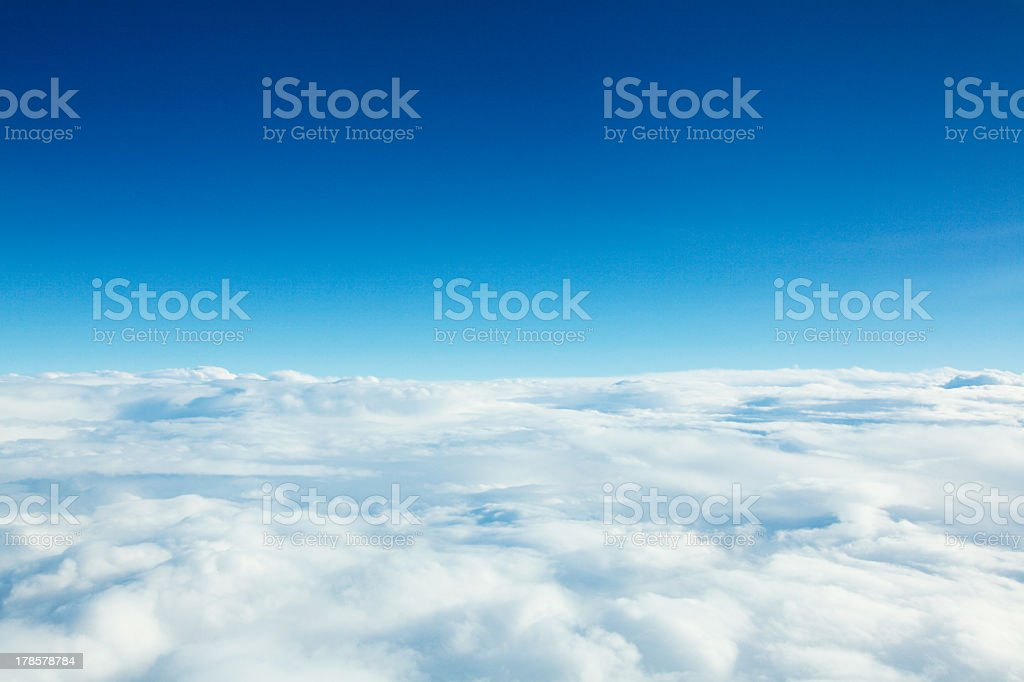 Photo of clouds from above and blue sky stock photo