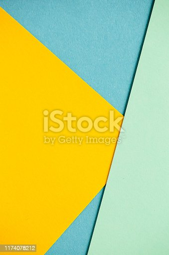 1197513976istockphoto Photo of colored sheets of paper: yellow, orange, blue, green. Suitable for design templates, covers, banners, reports, abstractions, wallpapers 1174078212