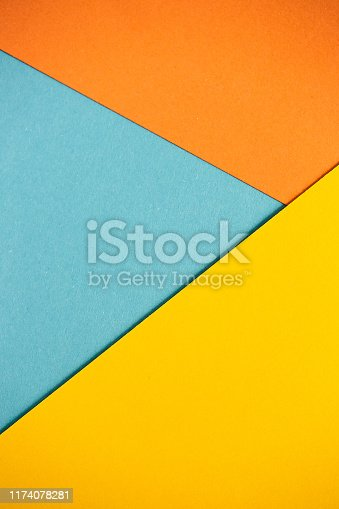 istock Photo of colored sheets of paper: yellow, orange, blue, green. Suitable for design templates, covers, banners, reports, abstractions, wallpapers 1174078281