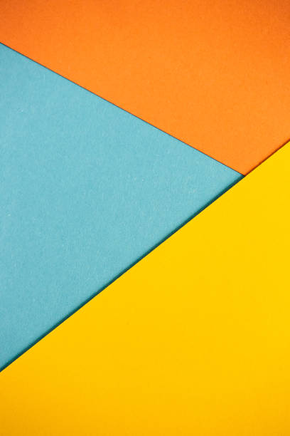 Cтоковое фото Photo of colored sheets of paper: yellow, orange, blue, green. Suitable for design templates, covers, banners, reports, abstractions, wallpapers