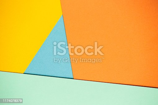 1197513976istockphoto Photo of colored sheets of paper: yellow, orange, blue, green. Suitable for design templates, covers, banners, reports, abstractions, wallpapers 1174078379
