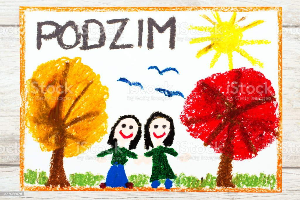 Photo of colorful drawing: Czech word Autumn, happy girls and trees with orange and red leaves stock photo