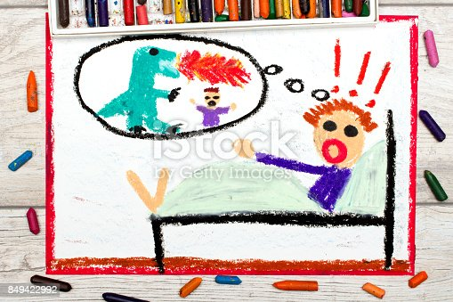 istock Photo of colorful drawing: Little boy has nightmares. Scary nightmare creature 849422992
