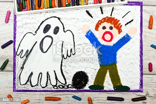 istock Photo of colorful drawing: Scary ghost with chains and scared little boy 843737700
