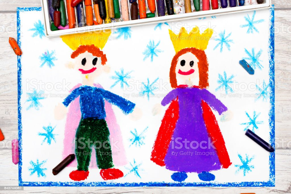 Photo of colorful drawing: smiling king and queen with their crowns stock photo