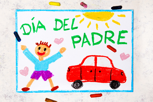 Photo of colorful drawing: Spanish lanquage, Father's day card. Happy father and his car.
