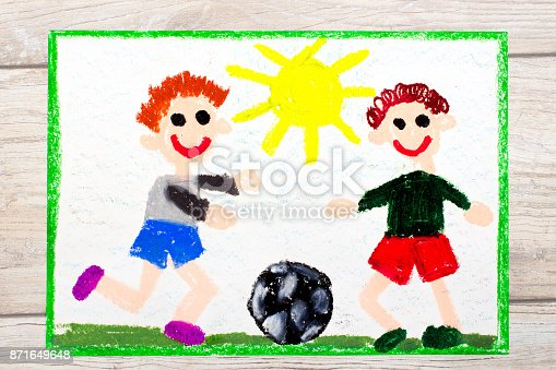 istock Photo of colorful drawing :Two little boys play football. Soccer game 871649648