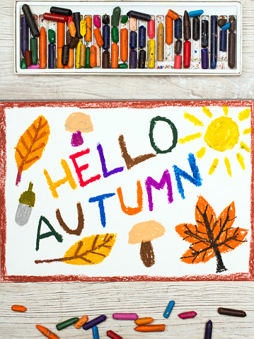 istock Photo  of   colorful drawing: Words HELLO AUTUMN mushrooms, acorn, yellow and orange leaves 842459772