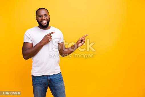 1163696387 istock photo Photo of confident cheerful black person pointing at yellow background he has been isolated with 1167715400