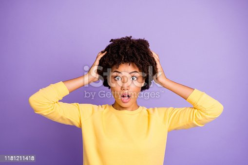 istock Photo of curly wavy scared frightened horrified brunette touching her hair observing them falling off expressing terrible emotions on her face feeling dander isolated purple pastel color background 1181211418