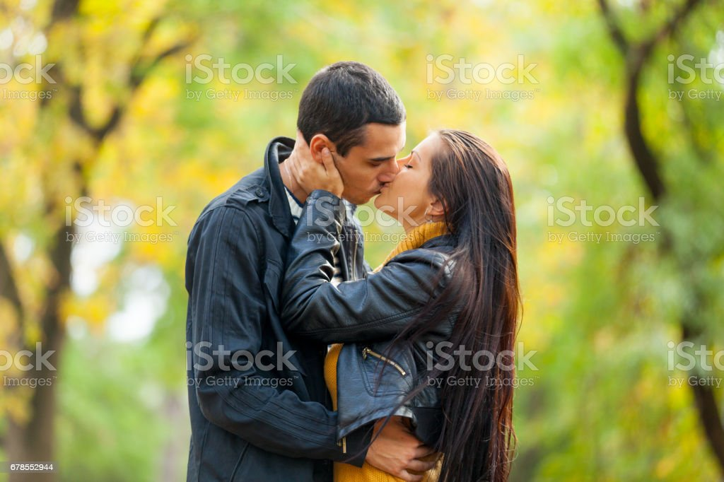 Photo Of Cute Couple Kissing On The Wonderful Autumn Park Background Royalty Free Stock