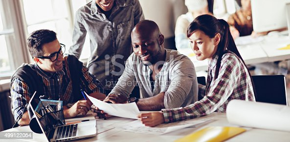 507263268 istock photo Photo of designers in good mood working together 499122054