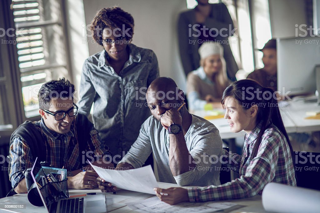 Photo of designers working together stock photo