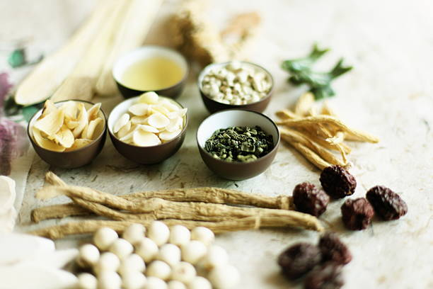 Photo of dried herbs, shaved nuts and other preserved foods  Traditional Chinese herbal medicine. chinese herbal medicine stock pictures, royalty-free photos & images