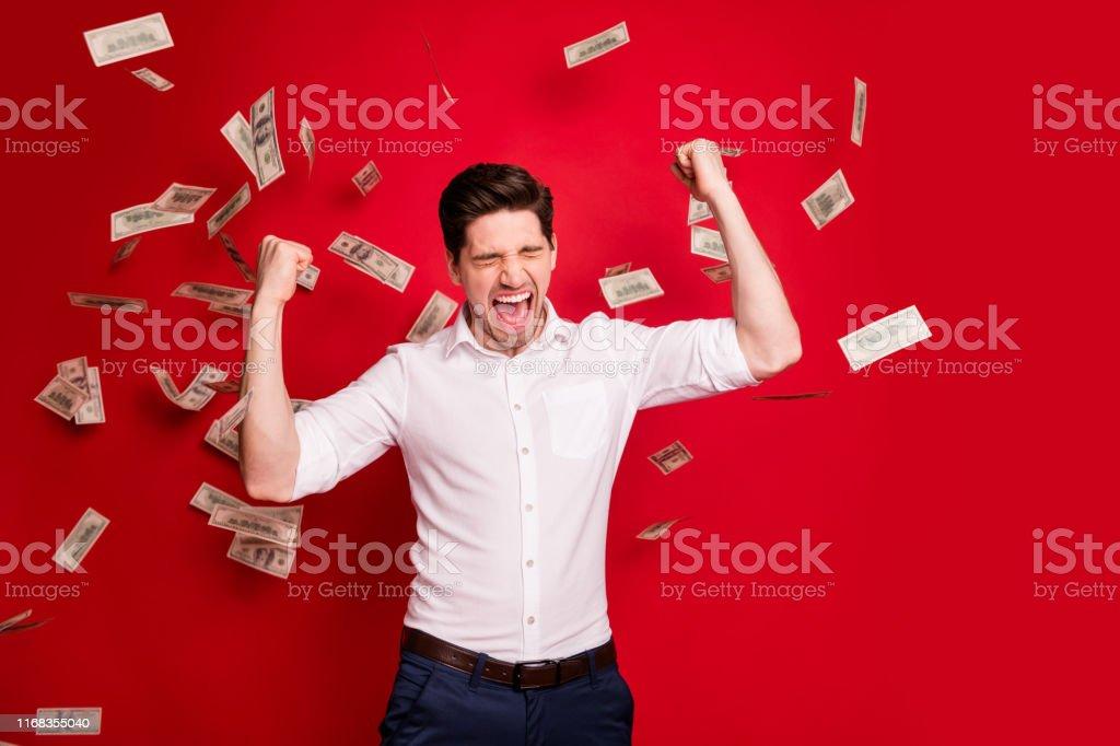 Photo of ecstatic overjoyed, man rained with bucks banknotes...