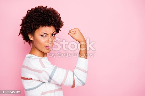 Photo of excited dark skin wavy lady raising fist angry on cheater boyfriends protecting, girlfriends wear white striped pullover isolated pastel pink color background