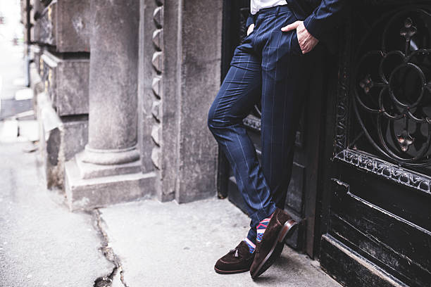 Photo of fashion man who crossed his legs. Photo of fashion man who crossed his legs. menswear stock pictures, royalty-free photos & images