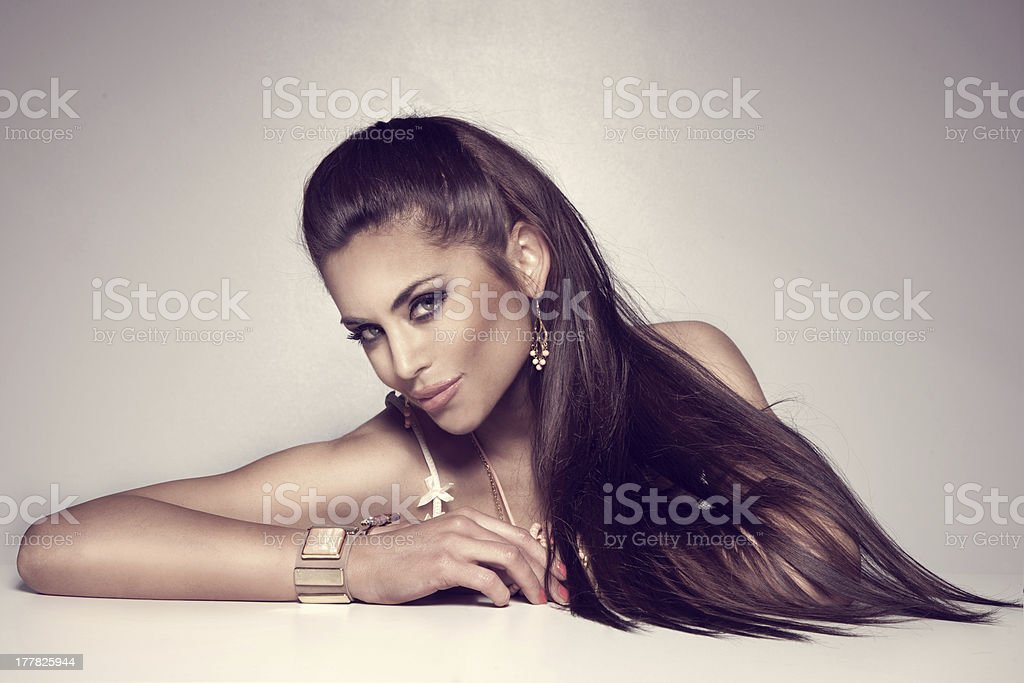Photo of fashionable brunette woman posing. stock photo