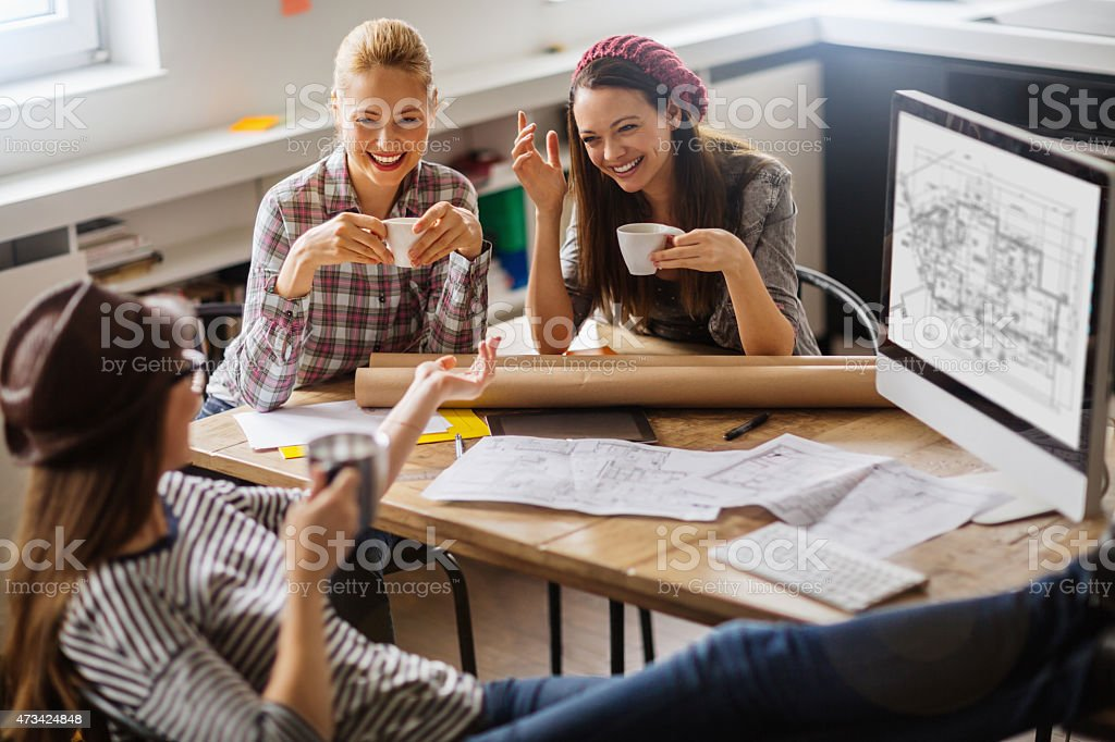 Photo of female freelancers relaxing at work stock photo