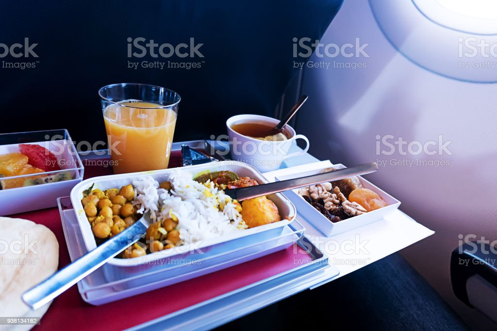 photo of Food served on board of economy class airplane on the table stock photo