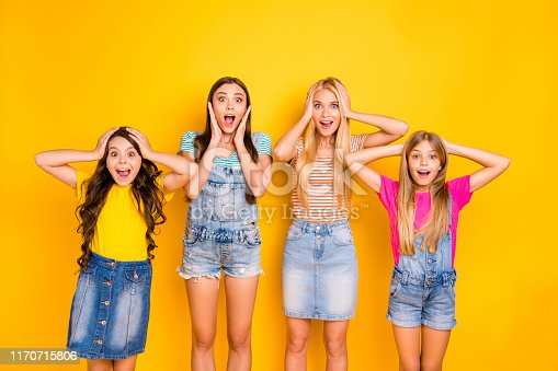 istock Photo of four cheerful with amazed facial expression open mouth shouting screaming ladies wearing denim overalls colorful t-shirts isolated bright background 1170715806
